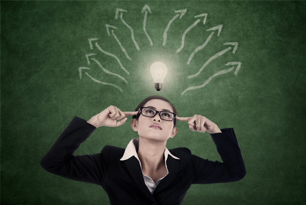 Businesswoman is searching for ideas with bright light bulb and arrows to represent mind map